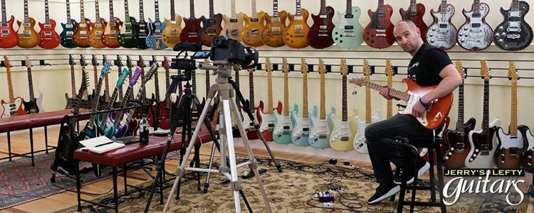 Shane Diiorio shooting videos of left hand guitars at Jerry's Lefty Guitars